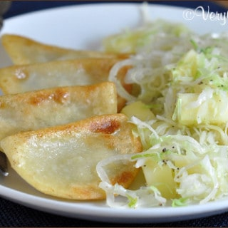 Potato and Cheese Pierogi with Sauteed Cabbage and Apples