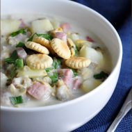 Chunky Clam Chowder loaded with potatoes, salt pork, clams, and topped with oyster crackers.