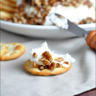 This French Quarter Cheese Spread topped with sugared pecans is the perfect sweet and salty combo! It's super easy and makes a festive appetizer for holiday get togethers!