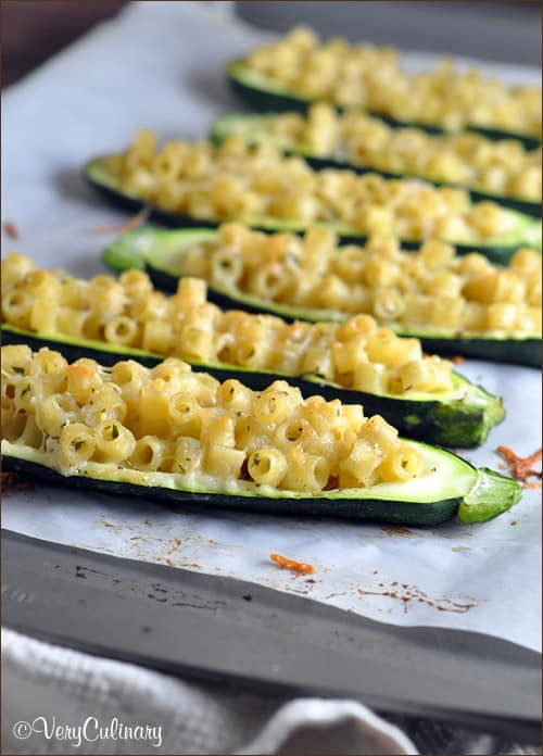 Zucchini is stuffed with delicious creamy pasta, and baked until tender. Perfect as an appetizer, side dish, or main meal! #stuffedzucchini #zucchiniboats #recipe