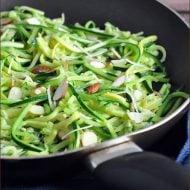 Super simple and tasty skillet zucchini recipe with garlic, Parmesan, and almonds #skillet #zucchini #recipe