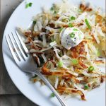 "Delicious hash browns, topped with Greek yogurt, scallions, and ""everything"" seasoning. Serve along side eggs or all on its own!"
