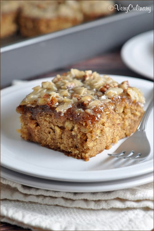 This oatmeal cake is moist and delicious, topped with coconut, pecans, and brown sugar - a dessert perfect for anytime!