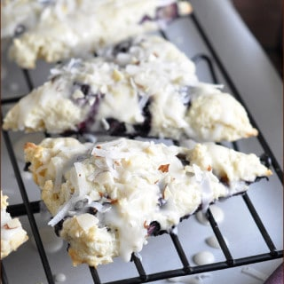 Tender flaky scones with fresh blueberries throughout and a dreamy coconut almond glaze!