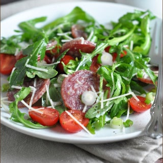 This salami salad comes together in 15 minutes, with baby greens, sweet cherry tomatoes, Parmesan, and a light dressing.