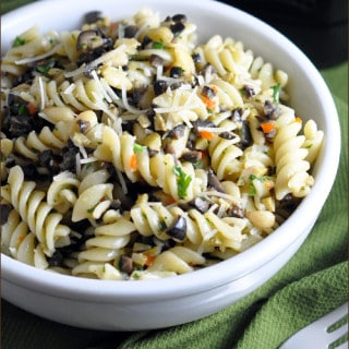 This is an ideal summer dish where olives and pine nuts are the stars. Simple, delicious, and the only cooking required is the pasta!