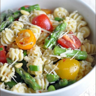 A quick and flavorful pasta salad with asparagus, tomatoes, and Italian dressing. Perfect for a potluck or light dinner!