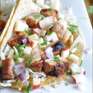 Grilled mesquite pork is diced up, then topped with an apple glaze and apple-onion slaw. Serve as tacos for an easy and delicious summertime meal!