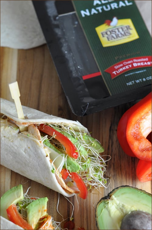 Flour tortillas are coated with an incredible spicy-sweet sauce, then topped with the turkey slices, Swiss cheese, bell pepper, avocado, and alfalfa sprouts. Fresh and light!