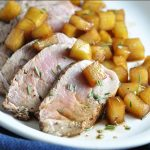 Pork tenderloin is seared in a delicious peppercorn garlic marinade, then topped with a balsamic and honey apple mixture.