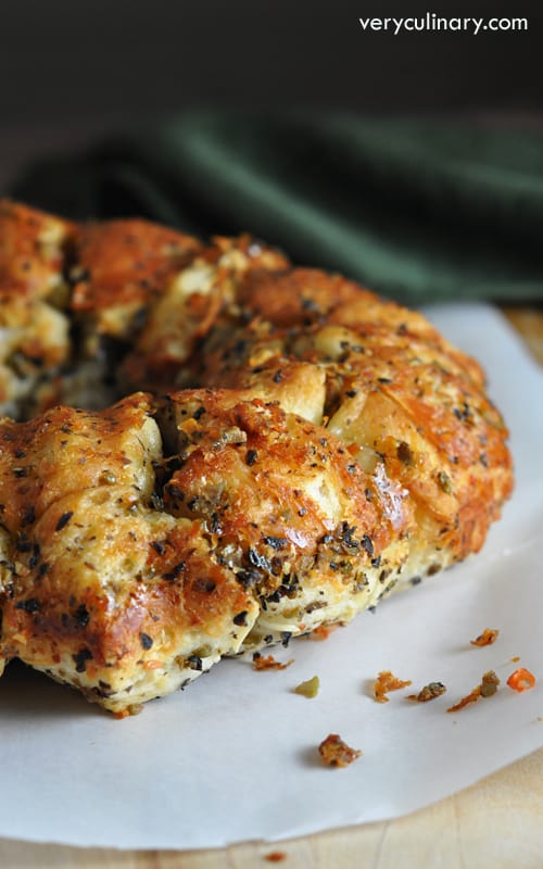 Super easy pull apart bread with butter, garlic, Parmesan, Italian seasonings, and olives are the star!