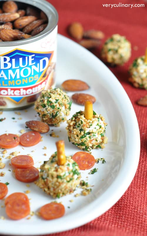 Mini pepperoni are coated in an herbed-cheese mixture, then rolled in smokehouse almonds for an easy and super tasty appetizer! #ad #GameChangingFlavors
