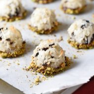 Coconut macaroons with dried cherries, dark chocolate, and roasted pistachios, making them perfect for the holidays!