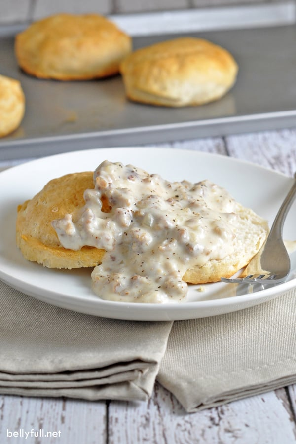 biscuits and gravy on white plate