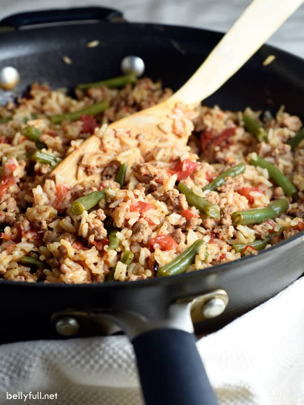 ground turkey skillet in pan with wooden spoon