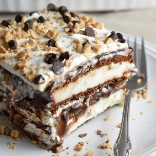 Layers of ice cream bars, hot fudge, caramel, whipped topping, and toffee pieces make this Hot Fudge Caramel Ice Cream Bar Cake look like you labored over it, while it's actually the easiest treat ever!