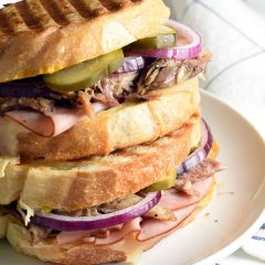 This Cubano Sandwich, inspired by the movie CHEF, combines slow roasted pork, ham, swiss cheese, onion, pickles, and mustard. It's incredibly simple and delicious!