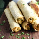 These chicken and cheese baked taquitos have the delicious flavor and crispy shell of the beloved deep fried version, but are easier, less messy, and healthier. Make them ahead, freeze, and have them ready in just minutes!