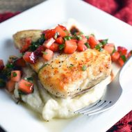 Pan-Seared Halibut is topped with fresh strawberry salsa, and sits on a rich and creamy cauliflower purée. It sounds so fancy, but it's incredibly easy to make!