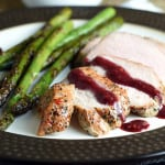 Pork sirloin is marinated in peppercorn and garlic seasonings, roasted to perfection, and served with a sweet and tangy blackberry sauce!
