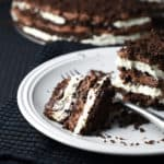 This Chocolate Icebox Cake is the ultimate treat with mascarpone whipped cream and Nutella whipped cream, layered with crushed chocolate graham crackers!