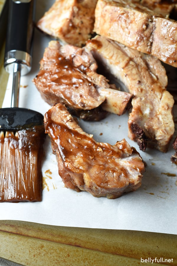 Baby Back Ribs are slow cooked in the oven with a delicious spice rub and a sweet and spicy sauce. After a few hours, the meat just falls off the bone!