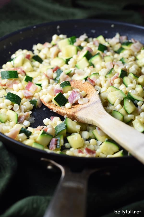 Fresh corn, zucchini, and bacon come together to create an amazing flavorful and easy skillet dish. Serve it as a side or on its own!