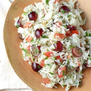 This cold Mexican Rice Salad is light, healthy, and delicious. Loaded with sweet grapes and robust pico de gallo, it's perfect for summer!