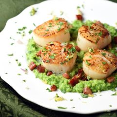 Pan seared scallops sit on top of rich pea puree, topped with crispy pancetta and Gremolata. A super easy dish, but tastes amazing and looks so elegant!
