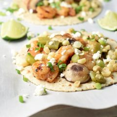 Easy Shrimp Fajitas with corn, mushrooms, poblano peppers, and feta cheese. Everything can be prepared on the grill or in a skillet, so you can make them all year round. Delicious 30 minute meal!