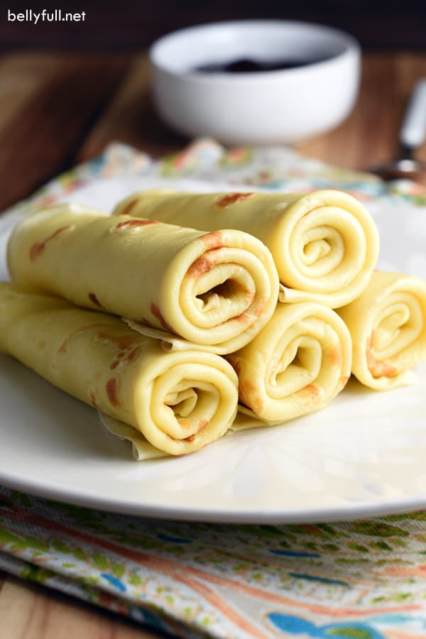 crepes rolled and stacked in a pyramid