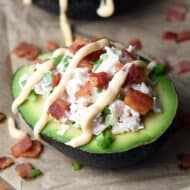 tuna stuffed avocado on parchment paper