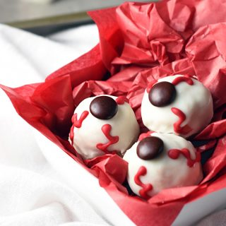 These Bloodshot Eyeballs will be staring at your Halloween party guests, just begging to be eaten. But don't worry - they're really yummy nut butter balls coated in chocolate!