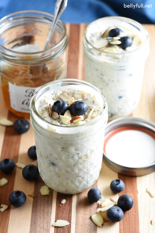 overnight oatmeal in jars with blueberries and apricot jam
