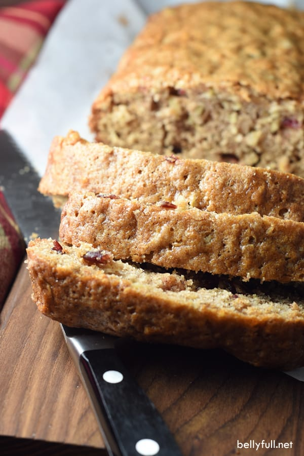 This quick bread is sweet and moist, filled with fresh grated apples and dried cranberries. The recipe makes two loaves, so you can freeze one for later!