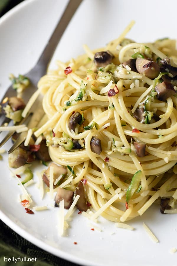 plate of pasta with zucchini and mushrooms