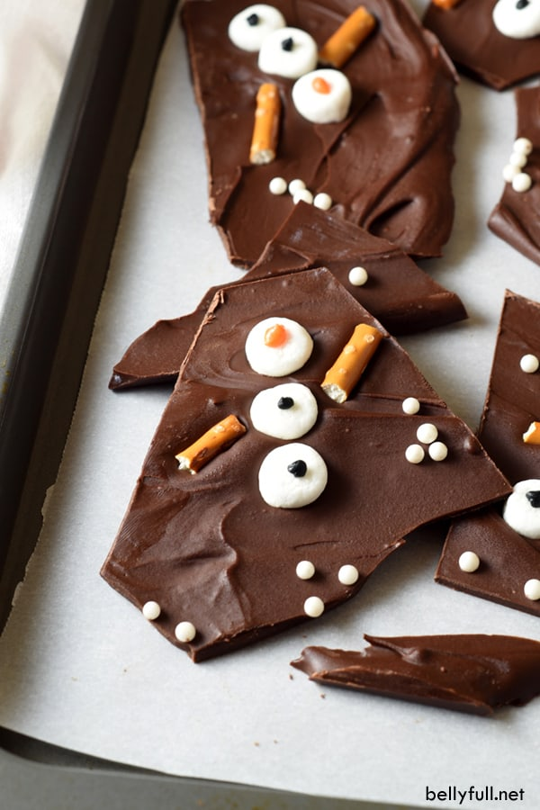 chocolate bark decorated with marshmallow pretzel snowman