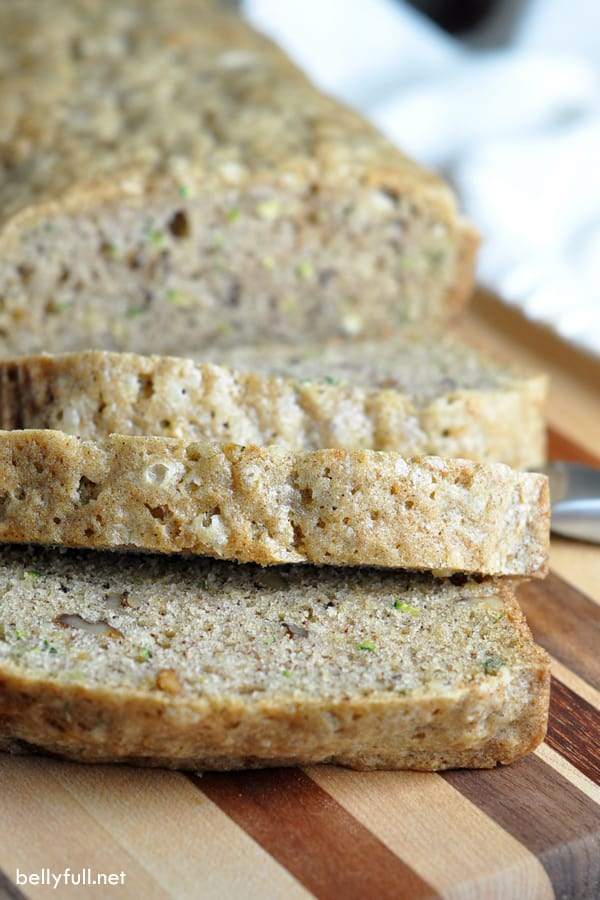 This quick bread is sweet and moist, filled with fresh grated zucchini and walnuts. The recipe makes two loaves, so you can freeze one for later!