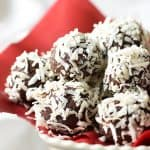 Easy Chocolate-Coconut Truffles made with chocolate, cream, butter, coconut rum, and cardamom, then rolled in coconut flakes. Ridiculously good!