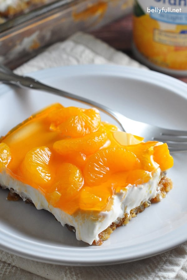 picture of sliced mandarin orange pretzel salad dessert on white plate