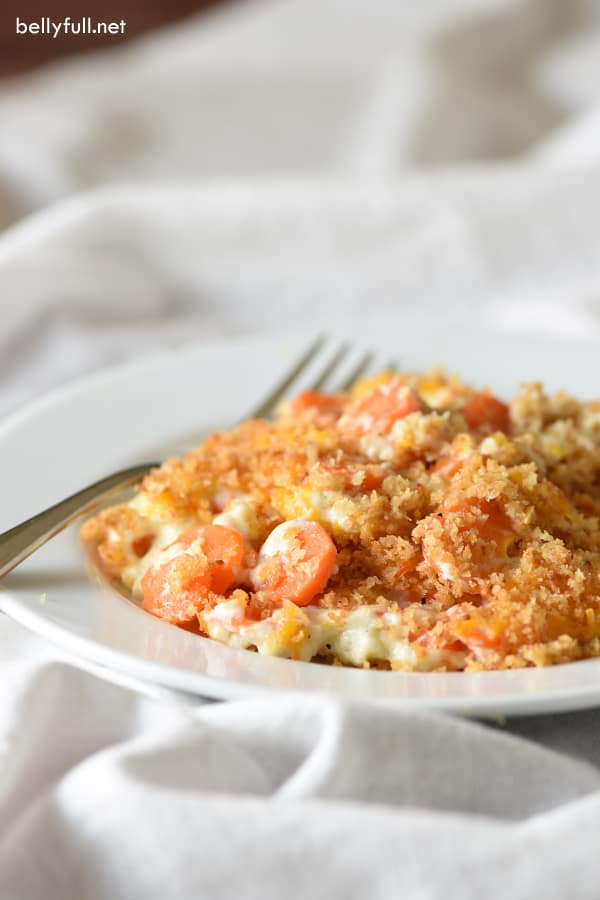 This Panko-Crusted Creamy Carrot Casserole will become your new favorite side dish! Made with carrots, a seasoned cream sauce, cheddar cheese, and topped with buttery breadcrumbs.