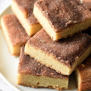 Chewy Snickerdoodle Cookie Bars - everyone's favorite snickerdoodle cookie in bar form. Chewy, buttery, and cinnamon-y. Good luck only eating one!