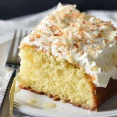 This Creamy Coconut Cake is a triple coconut treat! Buttery cake is infused with a luscious cream of coconut and condensed milk mixture, then covered in coconut whipped topping and toasted coconut. Heaven!