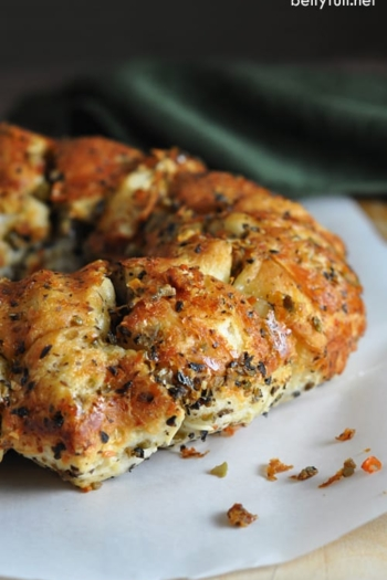 Easy Olive Pull-Apart Bread - super easy pull apart bread with butter, garlic, Parmesan, Italian seasonings, and olives are the star!