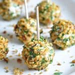 Herbed-Cheese Covered Olives - marinated olives are coated in an herbed-cheese mixture, then rolled in toasted nuts for an easy and super tasty appetizer!