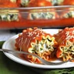 These lasagna rolls are a great twist on traditional lasagna, taking the mess out of it since they're prepared in individual servings. Noodles are spread with ricotta, Parmesan, spinach, and chicken, rolled up, and finished with a delicious red sauce.
