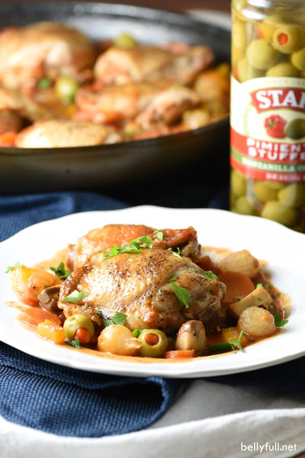 This Chicken Cacciatore is a simple Italian one pot meal with chicken, mushrooms, peppers, onion, and olives, braised in a tomato and wine sauce.