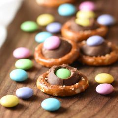 The easiest sweet and salty treat incorporating, pretzels, a Hershey's kiss, and pastel M&Ms for an Easter or spring flair. Make as many or as little as you want!