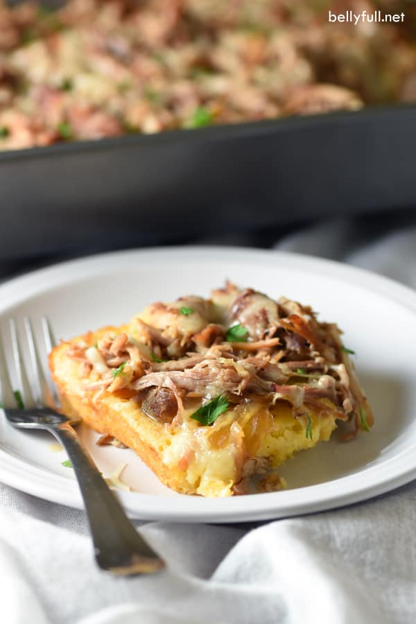 Sweet & Smoky Pulled Pork Cornbread Casserole - seasoned pork roast is slow cooked, then baked on top of savory cornbread and topped wth melted cheese to perfection!