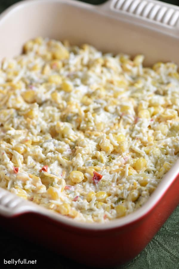 corn dip in a red baking dish